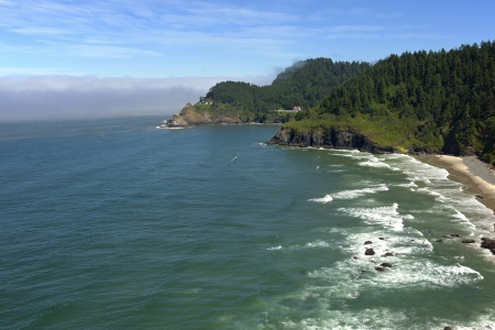 Hacenta lighthouse under restoration, and the Oregon coastline  photo