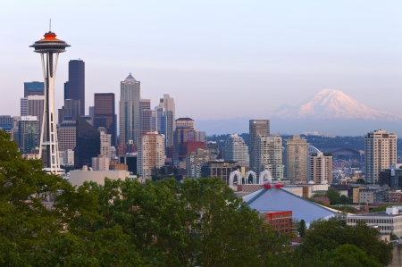 Seattle skyline at sunset and Mt Rainier  photo
