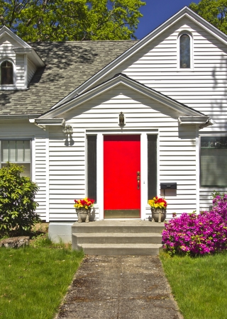 front of: House with a red door Hood River Oregon  Stock Photo