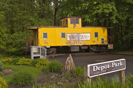 An open display of a old train car in a small park Troutdale Oregon