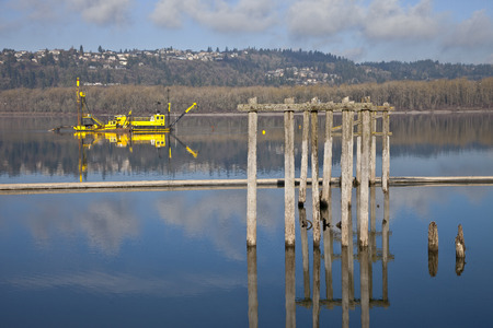 dredging: Dredging boats in the Columbia River Oregon.