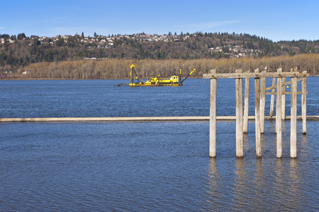yellow boats: Dredging boats in the Columbia River Oregon.