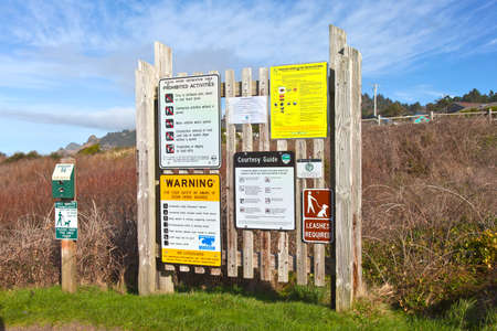 prohibitions: Signposts rules reminders and public warning at the beach Oregon coast. Stock Photo