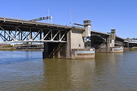 crossings: Morrison bridge crossings in Portland Oregon.