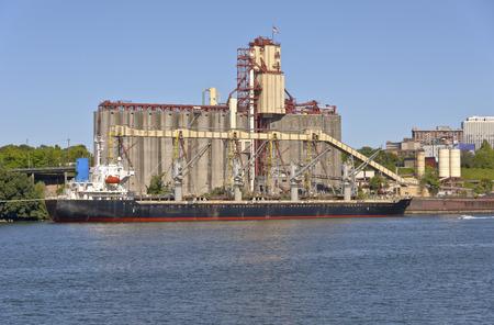 elevators: Cargo tanker ship and grain elevators Portland Oregon.