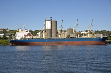 willamette: Cargo tanker ship waiting for a grain elevator in  Portland Oregon. Stock Photo