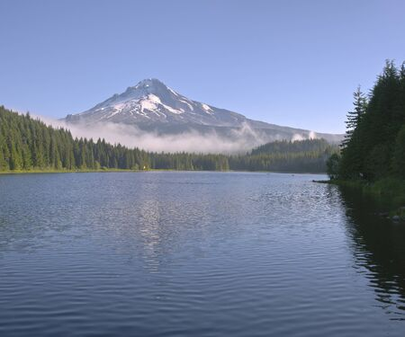 Trillium lake and Mt. Hood with morning fog Oregon state.