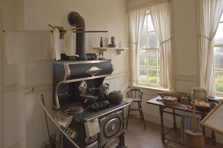 iron curtains: Antique kitchen setup of yesteryears Yaquina lighthouse museum Newport OR.