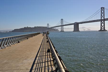 bay bridge: San Francisco promenade Bay bridge fog and Pacific ocean. Stock Photo