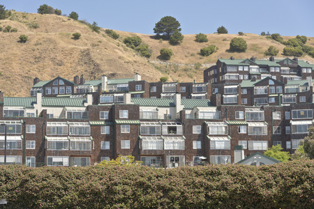 clustered: Houses and condominiums in a hillside Richmond California.