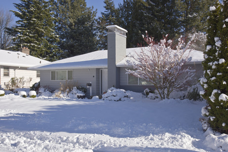 tall chimney: Family home and snow covered ground Gresham Oregon.