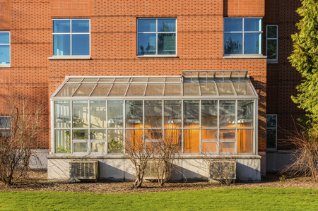 University of Portland building and green house glass enclosure. Editorial
