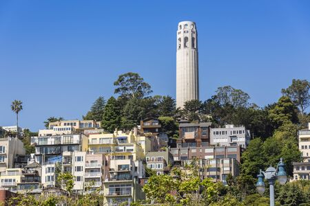 Coit Tower and surrounding buildings San Francisco CA. Imagens