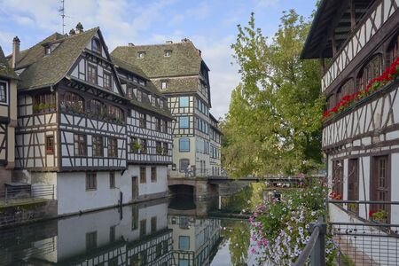 Small town atmosphere in Strasbourg France river and old buildings.