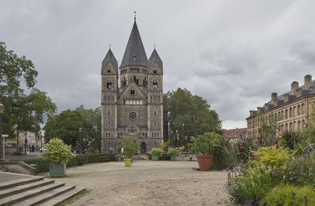 Metz France Cathedral park with overcast skies.