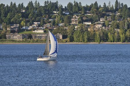 Sailboat on the Columbia river with Vancouver Washington in the background. Stock fotó