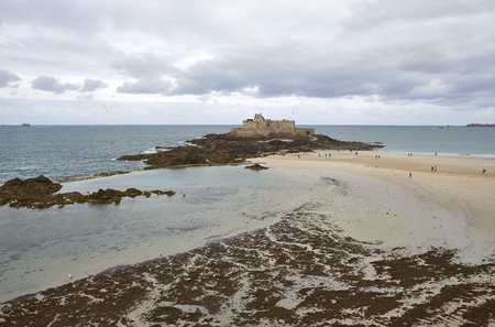 Bech and castle in France with the English channel sea.
