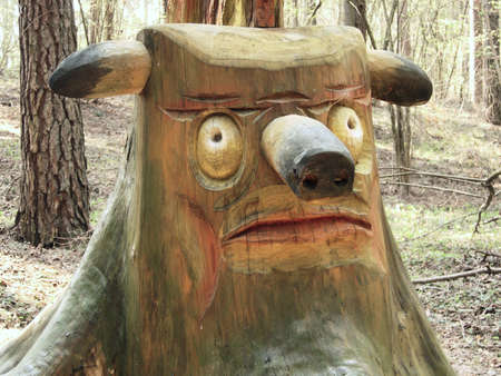 woodcarving:           Woodcarving figure of stump in forest  Stock Photo