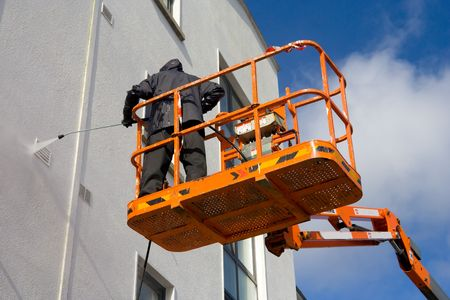 woker in black unifom in the cherry picker