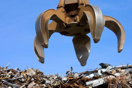 grabber: grubber up on metal heap Stock Photo