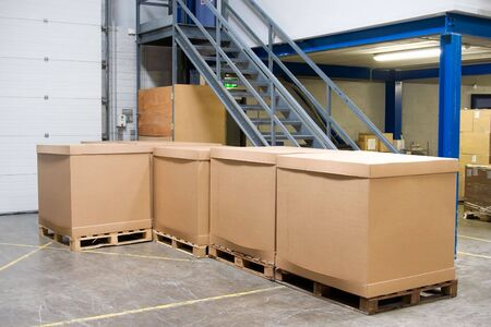 pallets with cartons in warehouse photo