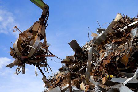 crane grabber loading a metal garbage photo