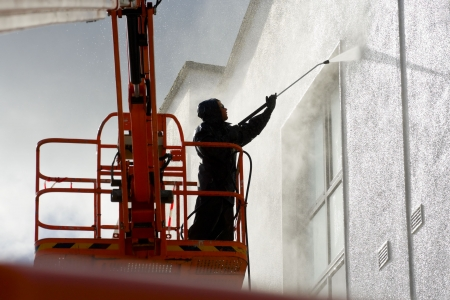 worker washing a wall Stock Photo