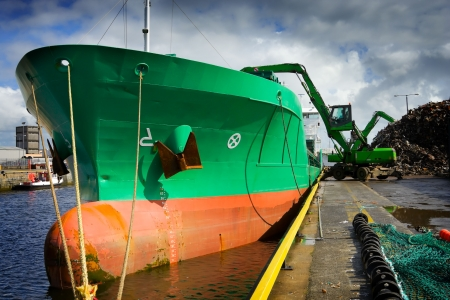 Crane Loading A Ship With Recycling Steel Stock Photo - 5661820
