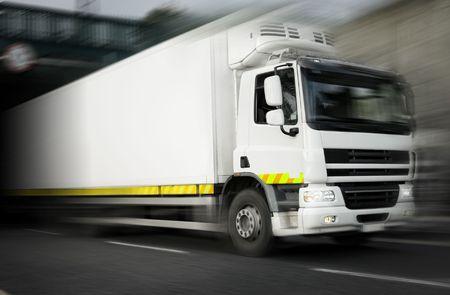 fuel truck: white refrigerator Truck  in motion