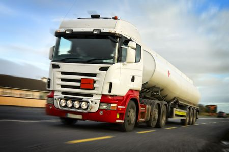 fuel truck in motion on the busy country road