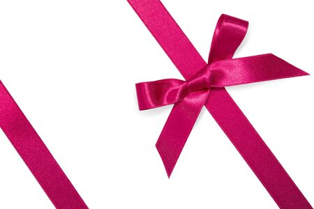 purple diagonal ribbon with bow isolated on white photo
