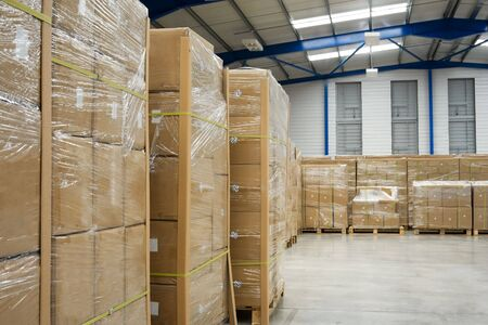 warehouse interior: industrial warehouse interior and pallets with cardboard cartons