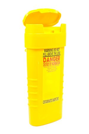 selfcontrol: yellow container for used syringes and needlles isolated