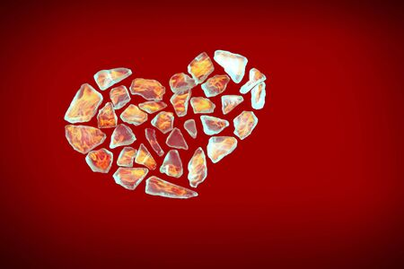 broken crystall heart shape on red background photo