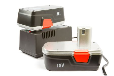 constraction: rechargeble batterys and charger for cordless hammer drill, isolated Stock Photo