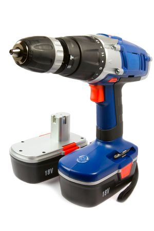 constraction: cordless hammer drill and spare rechargeable battery, isolated