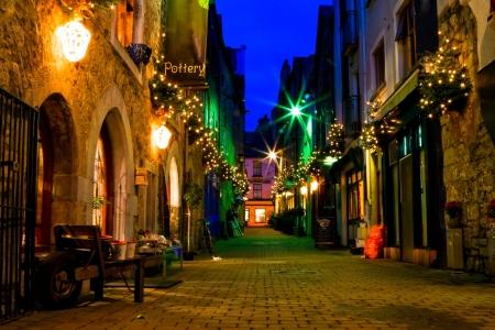 ireland: old Galway city street,Kerwans Lane,decorated with christmas lights,night scene
