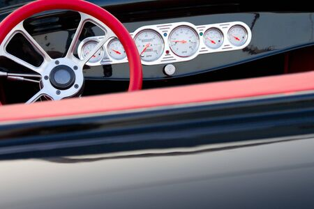 stylish steering wheel and dashboard in vintage car photo