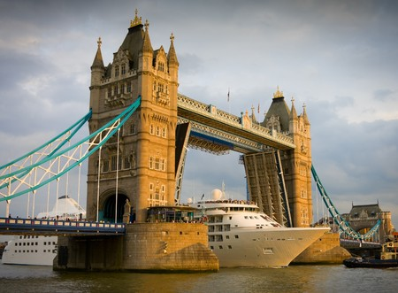 passenger ship: Tall White Cruise ship passing Londons Tower Bridge at sunset Stock Photo