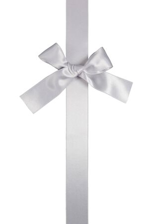 silver ribbon: silver colore vertical ribbon with bow isolated on white background Stock Photo