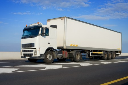 Truck with big white trailer On The Highway Imagens