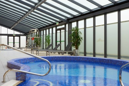 public health: hydromassage pool with water in Hotel Leisure Center Interior