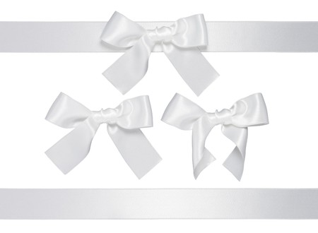 white multiple ribbon with bow isolated on white background photo