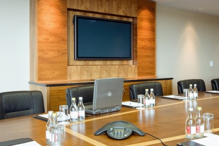 conference hall Interior with laptop on the table and big screen  on the wall Stock Photo - 7961842