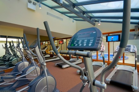 simulators: gym interior with equipment and row of jogging simulators