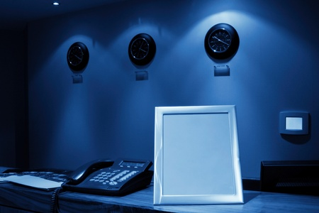 hotel reception desk with phone and row of clock on the wall, monochromatic Stock Photo - 8363575