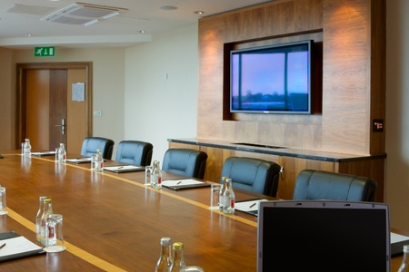 conference hall Interior with laptop on the table and big screen  on the wall photo