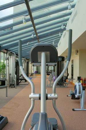 simulators: gym interior with equipment and row of jogging simulators
