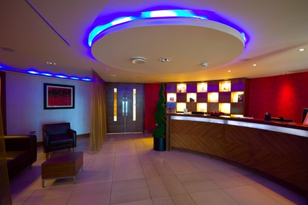 SPA reception interior with desk and multicolored lightig in Hotel