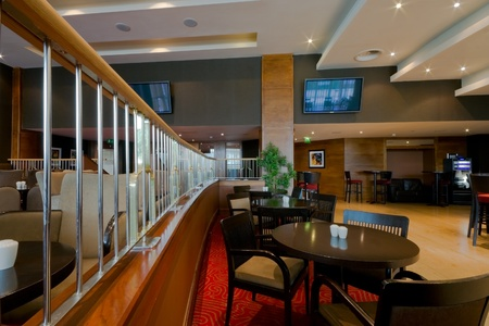 wall bars: Hotel bar-restaurant interior with chairs and tables